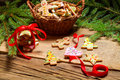 Gingerbread cookies for christmas scrolled red ribbon on old wooden table Stock Photography