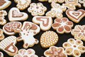 Gingerbread cookies in the form of a rabbit, flowers, hearts, grandmothers and Easter eggs, covered with white and chocolate icing