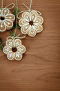 Gingerbread cookies hanging over wooden background Stock Images