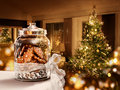 Gingerbread cookies jar christmas tree room background Royalty Free Stock Photography