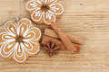 Gingerbread cookies with star anise and cinnamon hanging over wooden background cinamon Stock Photo