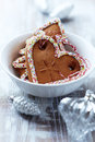 Gingerbread cookies in a white bowl and glass ornaments Royalty Free Stock Photography
