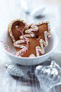 Gingerbread cookies in a white bowl and glass ornaments Royalty Free Stock Image