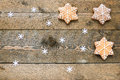 Gingerbread cookies on wooden background with snowflakes with space for your text christmas different shapes are right corner of Royalty Free Stock Photo