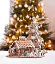 Gingerbread cottage house and christmas tree home interior background Royalty Free Stock Images