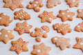 Gingerbread gingerbread man pines and stars is decorated by sugar balls snowflakes sprinkles selective focus Royalty Free Stock Images