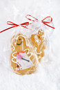 Gingerbread girl cookie gift in clear bag on a festive christmas snow background nice postcard Royalty Free Stock Photography