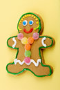 Gingerbread girl gumdrops sprinkles smiling face Stock Photos