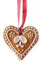 Gingerbread heart christmas cookie hanging on white background Stock Photography