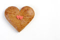 Gingerbread heart with two red sweet heart on white background Royalty Free Stock Photo