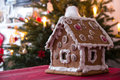 Gingerbread house and christmas tree Stock Photos