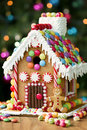 Gingerbread house decorated with colorful candies Stock Photos