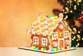 Gingerbread House over Christmas Tree Royalty Free Stock Photo