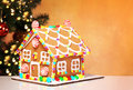 Gingerbread House over Decorated Christmas Tree Royalty Free Stock Photo