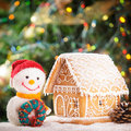Gingerbread house over on the snow and lovely handmade snowman Stock Images