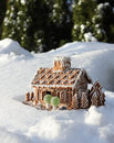 Gingerbread house in real winter snow christmas background Royalty Free Stock Image