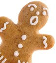Gingerbread man close up of on white background Stock Photos