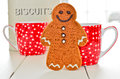Gingerbread man home made ginger bread with coffee cups and biscuit tin Stock Photos