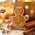 Gingerbread man shortbread cookies spices and candle Stock Photos