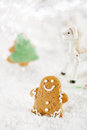 Gingerbread man and tree on a festive christmas snow background nice postcard Stock Photography