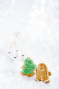 Gingerbread man and tree on a festive christmas snow background nice postcard Stock Images