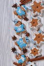 Gingerbread men and christmas stars on the table Royalty Free Stock Photo