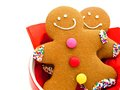 Gingerbread men close up of two in a red bowl Royalty Free Stock Photography