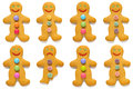 Gingerbread men odd one out smiling with exception isolated on a white background Royalty Free Stock Images