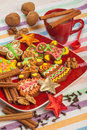 Gingerbread on a red plate, Christmas cookies Stock Photos