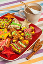 Gingerbread on a red plate white cup, Christmas co Royalty Free Stock Photos