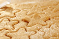 Gingerbread  star cookie cuts dough Royalty Free Stock Photo