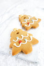 Gingerbread tree cookies on white wood and snow background festive christmas nice postcard Stock Image