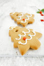 Gingerbread tree cookies on white wood and snow background festive christmas nice postcard Royalty Free Stock Images