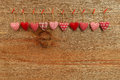 Gingham love valentine s hearts hanging on wooden texture backgr natural cord and red clips rustic plywood background copy space Stock Photos
