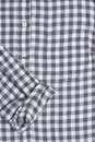 Gingham shirt front of a with a rolled up sleeve Stock Photography