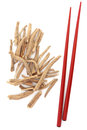 Ginseng herb with red chopsticks over white background ashwagandha Royalty Free Stock Image