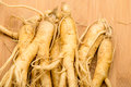 Ginseng over the wooden background Royalty Free Stock Photo