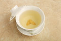 Ginseng tea a cup of on the table Royalty Free Stock Photo