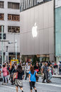 Ginza shoppers and tourists wander past a large mac store in on september in tokyo japan Royalty Free Stock Photo