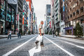 Ginza shoppers and tourists wander the streets of on september in tokyo japan Stock Photography