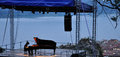 Giovanni allevi piano concert outdoor lake view Royalty Free Stock Image