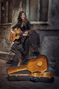 Gipsy girl playing guitar Royalty Free Stock Photo