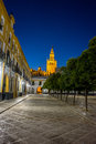 The Giralda bell tower lit up at night in Seville, Spain, Europe Royalty Free Stock Photo