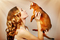Girl with Abyssinian cat Royalty Free Stock Photography