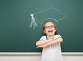 Girl with academic cap drawing on school board Royalty Free Stock Photo