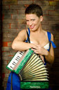 The girl with an accordion Royalty Free Stock Photo