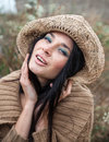 Girl against background of nature and old concrete wall portrait a in a straw hat Stock Images