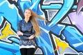 Girl against grafitti wall Royalty Free Stock Photo