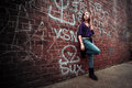 Girl against urban wall Royalty Free Stock Photo