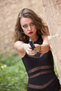 Girl aiming with gun Royalty Free Stock Photo